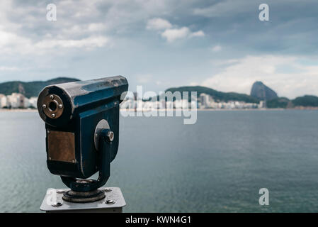 Viewing telescope overlooking Copacabana Beach in Rio de Janeiro, Brazil - Stock Photo