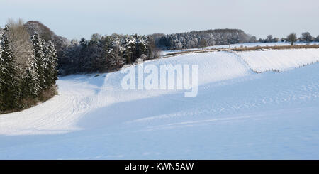 Snow in a field in the cotswold countryside. Cotswolds, Gloucestershire, England. Panoramic - Stock Photo