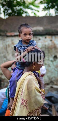 Bodhgaya, India - Jul 9, 2015. A woman with her son on street in Bodhgaya, India. Bodh Gaya is considered one of - Stock Photo