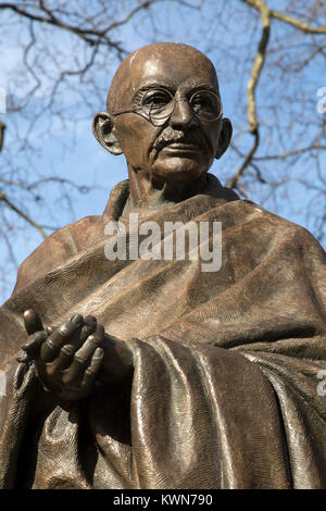 Statue of Mahatma Gandhi at Parliament Square in London, England. Gandhi (1869 - 1948) was a leader in India's struggle - Stock Photo