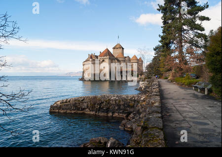 The Château de Chillon Castle on Lake Geneva, a medieval fortress, historic monument and tourist attraction near - Stock Photo