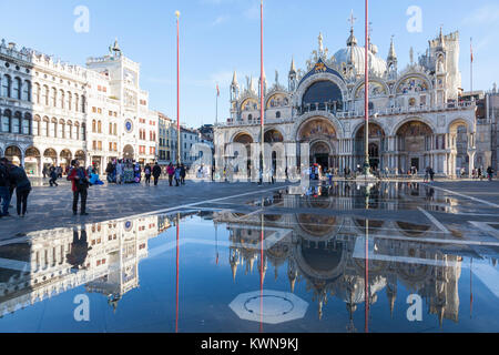 Piazza San Marco and the Basilica  San Marco reflected in Acqua Alta high tide, Venice, Italy on a sunny day in - Stock Photo