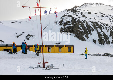 Cruise ship visitors to the Arctowski; Polish Research Station; King George Island; Antarctica - Stock Photo