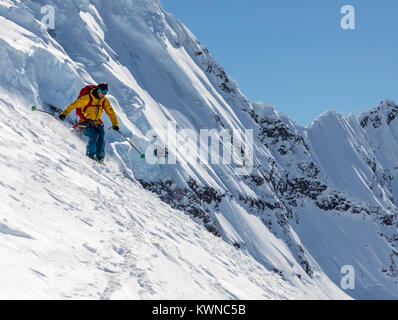 Alpine ski mountaineer skiing downhill in Antarctica; Nansen Island - Stock Photo
