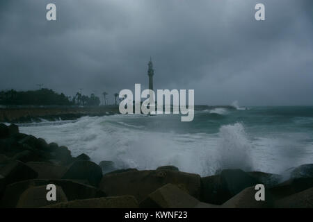 Waves breaking on the shore of the Mediterranean sea in winter - Stock Photo