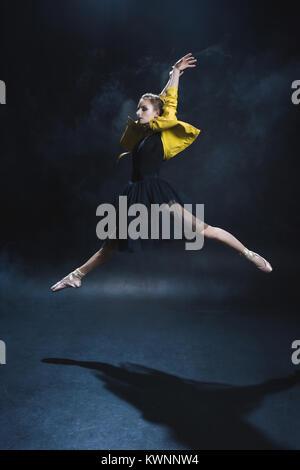ballerina in tutu and leather jacket  - Stock Photo