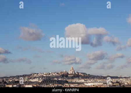 montmartre and sacre coeur seen from building of centre pompidou with blue sky - Stock Photo