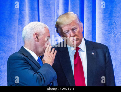 New York, USA, 11 January 2017.  US President-elect Donald Trump (R) listens to his Vice-President-elect Mike Pence - Stock Photo