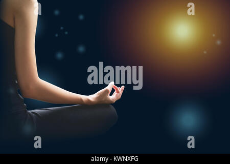 Close-up of feminine and masculine arms and crossed legs during meditation. - Stock Photo