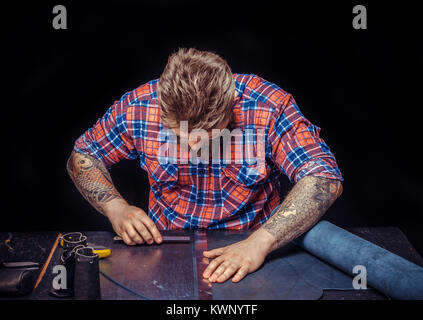 Tanner focusing on his work at the desk - Stock Photo