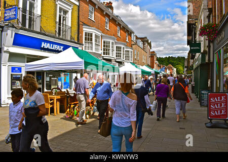 Shoppers strolling through the street market in the High Street, Winchester - Stock Photo