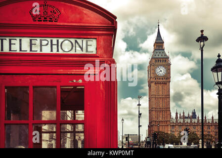Big Ben, a phone booth and a bus stop sign in London UK