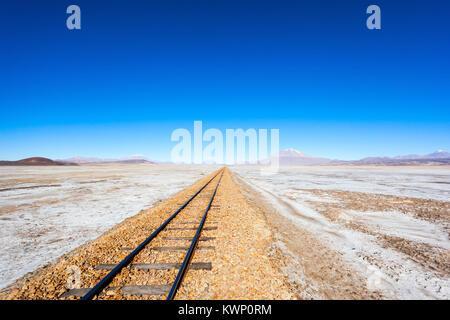 Old railway in Salar de Uyuni (salt flat), Bolivia - Stock Photo