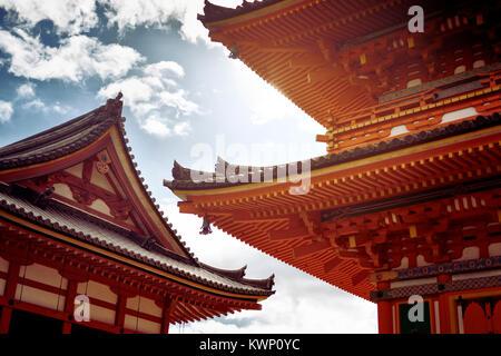 Architectural detail of Sanjunoto bright orange pagoda building at Kiyomizu-dera Buddhist temple in Kyoto, Japan - Stock Photo