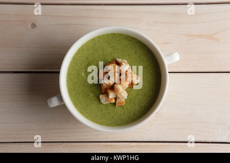 Plate of pea soup puree with crackers - Stock Photo