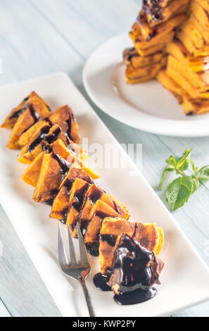 Pumpkin pancakes with chocolate topping - Stock Photo