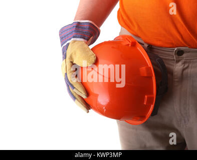 worker in protective gloves holds an orange hard hat in his hand. Safety helmet. - Stock Photo