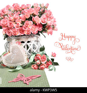 Border image with many pink roses and stuffed heart on white background. Space for your text or greeting on the - Stock Photo