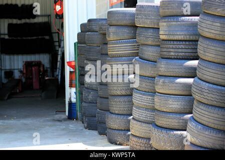 Stack of black tyres or black tires in Australia. - Stock Photo