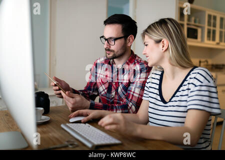 Young attractive designers working together from home - Stock Photo