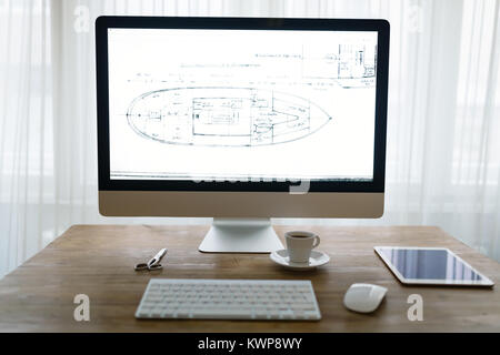 Picture of office desk with tablet computer and other accessories - Stock Photo