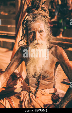 Sadhu man with traditional painted face and body in Varanasi, India - Stock Photo