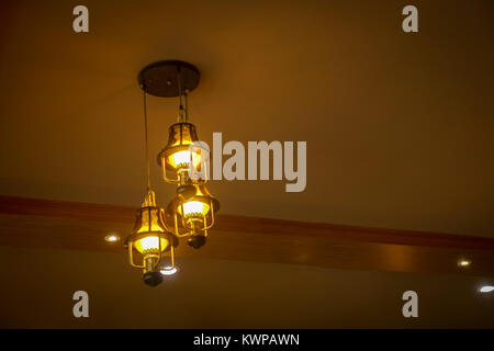 Closeup view of contemporary light fixture at the restaurant - Stock Photo