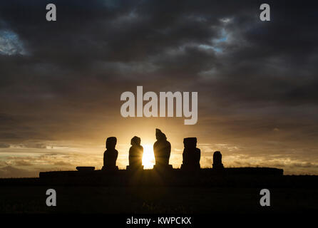 Sunset at the statues of Ahu Tahai at Easter Island (Rapa Nui/ Isla de Pascua), Chile - Stock Photo