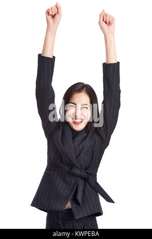 studio shot of a young asian business woman celebrating success, arms up, isolated on white background. - Stock Photo