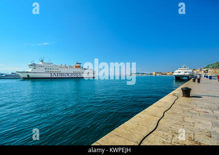 Boats, yachts and ferries in the harbor of the ancient city of Split Croatia along the Dalmatian coast of the Adriatic - Stock Photo