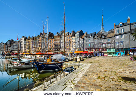 The Vieux-Bassin, old pier at the Normandy village of Honfleur France with it's slate covered, timber framed homes - Stock Photo
