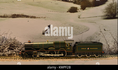A model of the 4-6-0 locomotive King Henry VIII set against a winters backdrop - Stock Photo