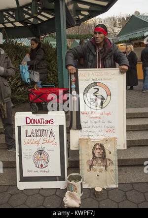Native American man from the Lakota Nation in North Dakota; advocates and tries to raise money at Union Square in - Stock Photo