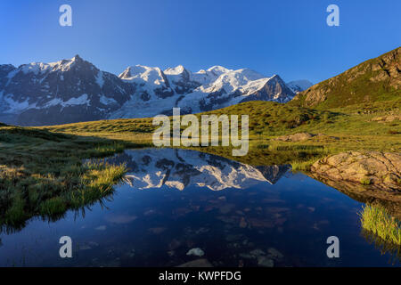 Mont Blanc massif reflected in lake. France - Stock Photo