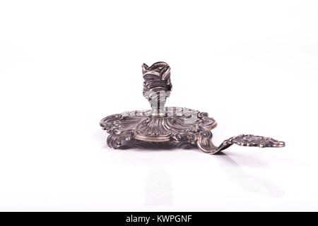 handcrafted silver candlestick over a wite background - Stock Photo