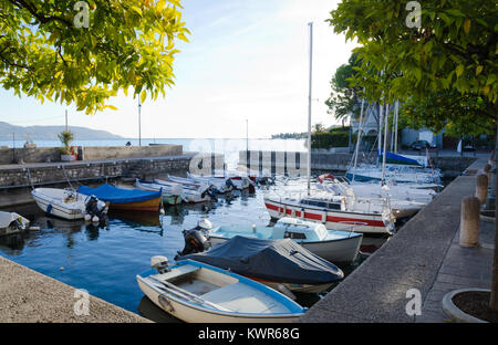 GARGNANO, LAKE GARDA, ITALY. 24th October 2017. Small boats lying moored up for the Autumn in the little harbour - Stock Photo