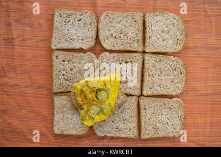 composition of slices of sandwich bread with a slice of zucchini omelette - Stock Photo
