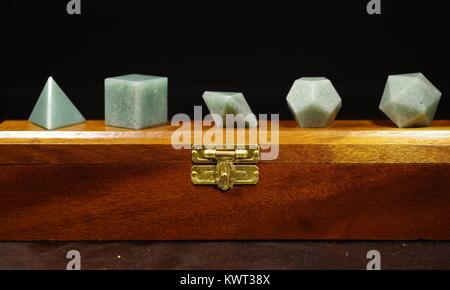 Wooden Display Box of Geometric Crystal Shapes, Representing the Greek Elements, Platonic Solids. Macro Photo, Devon, - Stock Photo