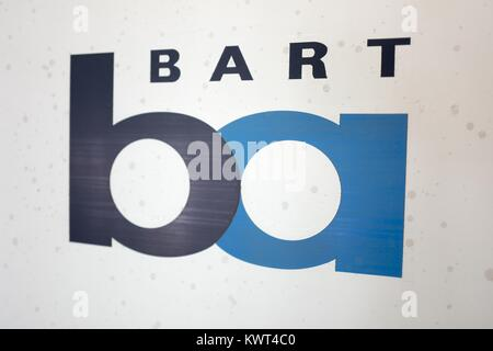 Close-up of sign with logo for the Bay Area Rapid Transit (BART) light rail system on the side of a BART train in - Stock Photo