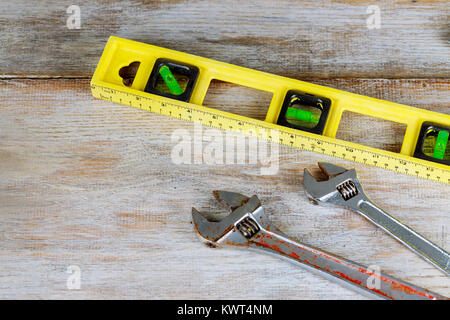 Plumbing Tools Composition Of Brass Pipe Connectors On Wooden Board and Sonstruction equipment tools - Stock Photo