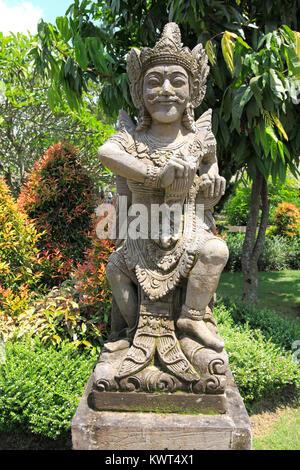 Statue near the entrance to Pura Taman Ayun, the royal temple at Mengwi, Badung, Bali, Indonesia. - Stock Photo