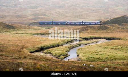 Corrour, Scotland, UK - September 26, 2017: A pair of Scotrail Class 156 'Sprinter' passenger trains pass the Corrour - Stock Photo