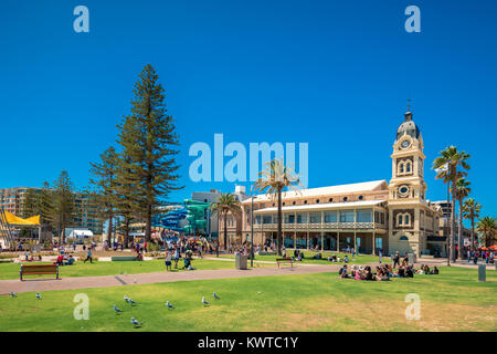 Adelaide, Australia - February 28, 2016: People relaxing in public park at Moseley Square in Glenelg on a bright - Stock Photo
