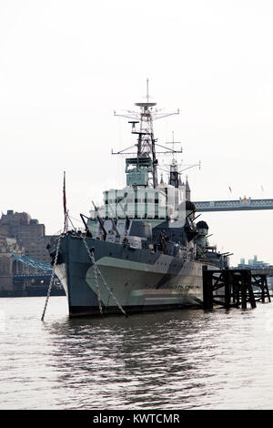 HMS Belfast on the River Thames in London, England. The heavy cruiser is part of the Imperial War Museums. - Stock Photo