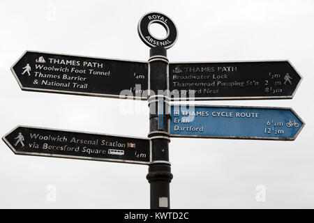 Sign at Royal Arsenal in London, England. The sign points to places of interest along the footpath and cycle track - Stock Photo