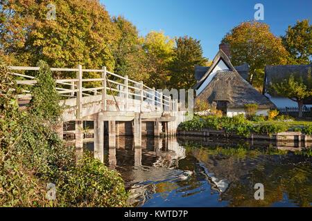 Flatford Bridge and Bridge Cottage on the River Stour in Dedham Vale, Suffolk, England - Stock Photo