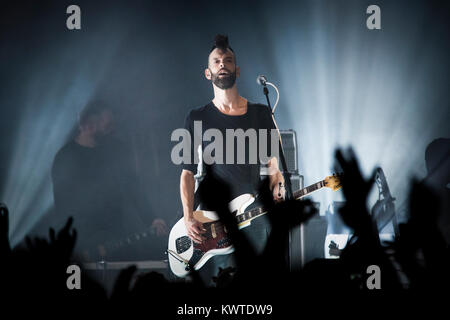 The English rock band Placebo performs a live concert at VEGA in Copenhagen. Here musician Stefan Olsdal is seen - Stock Photo