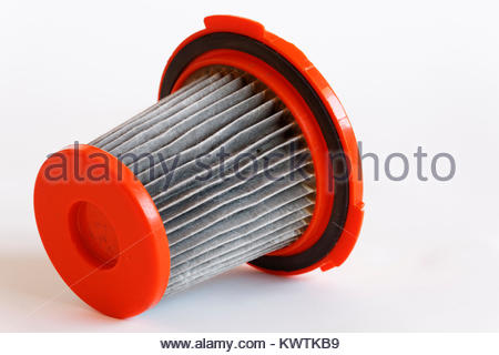 Close-up of clogged vacuum cleaner filter on white background - Stock Photo