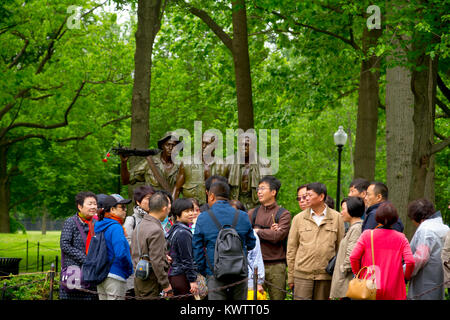 Vietnam Veterans Memorial, in Washington DC,  'The Three Soldiers' statue by Frederick Hart  Chinese tourists - Stock Photo