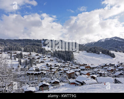 Looking down on the winter ski resort of Les Gets with the runs of Chavannes and the family slopes - Stock Photo